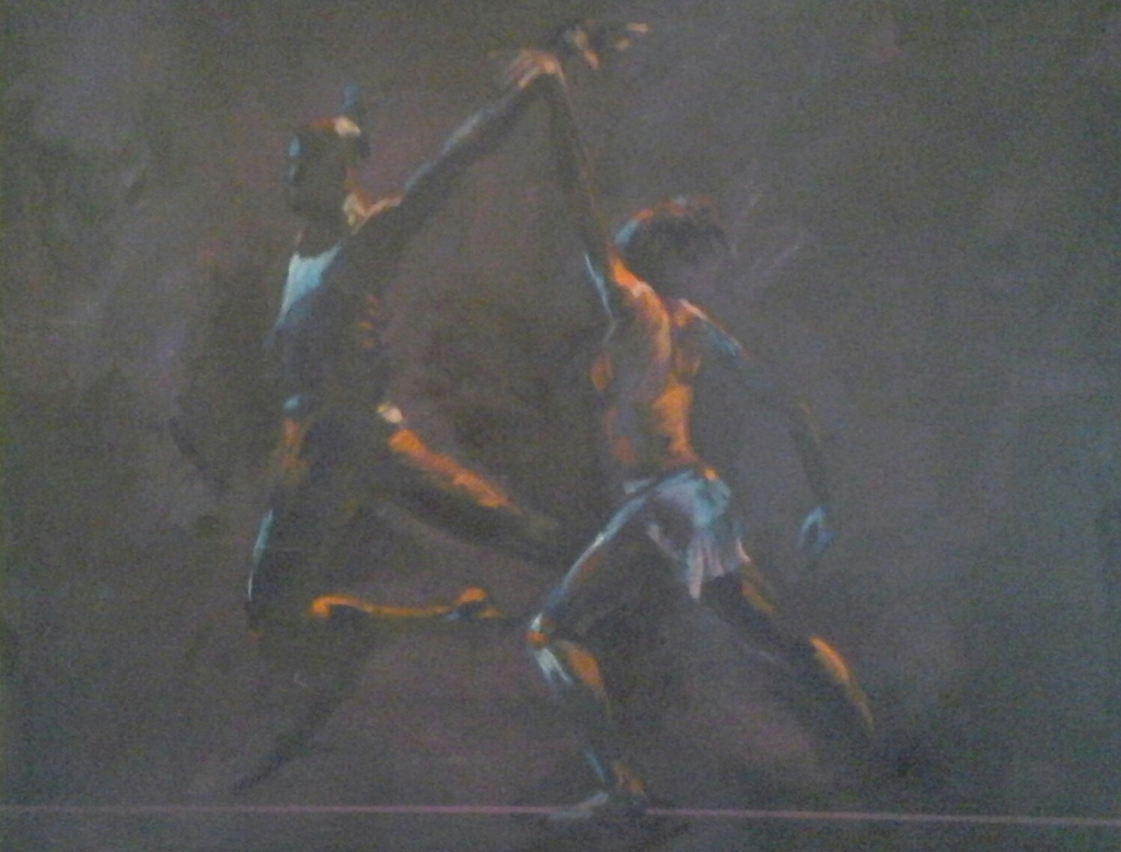 man and woman dancing together dark background