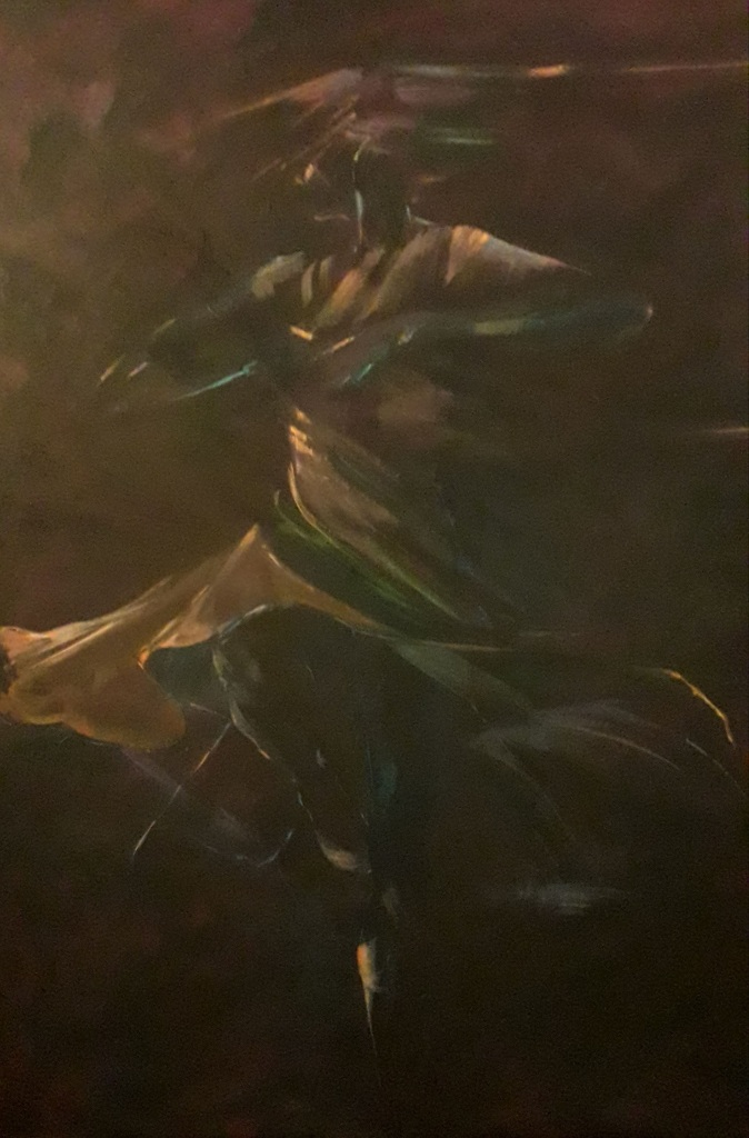 female dancer spinning brown background